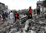Palestinians search for victims of an Israeli attack