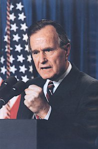 President George H.W. Bush, fist clenched, ready to smack down the Vietnam Syndrome