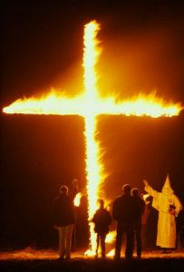 ca. 1987, Near Twin Falls, Idaho, USA --- Members of the Ku Klux Klan and the Aryan Nations gather outside Twin Falls, Idaho for a cross burning. --- Image by © Matthew Mcvay/CORBIS
