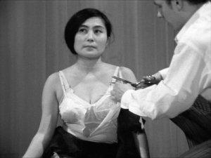 Yoko_Ono_-_Cut_Piece_1965_-_227.jpg.935x300_q85
