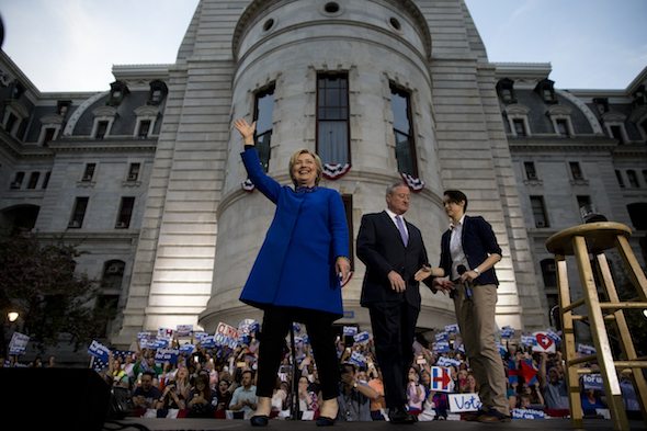 Democratic presidential candidate Hillary Clinton arrives, accompanied by Mayor Jim Kenney for a during a campaign stop, Monday, April 25, 2016, at City Hall in Philadelphia. (AP Photo/Matt Rourke)