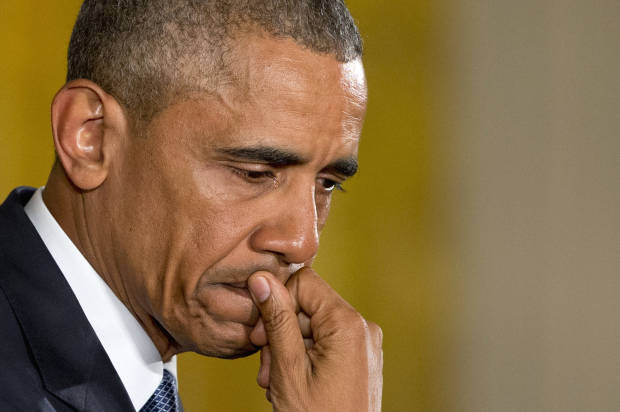 An emotional President Barack Obama pauses as he speaks about the youngest victims of the Sandy Hook shootings, Tuesday, Jan. 5, 2016, in the East Room of the White House in Washington, where he spoke about steps his administration is taking to reduce gun violence. (AP Photo/Jacquelyn Martin)