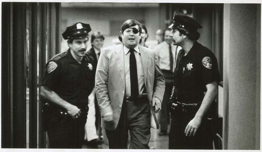 Warren Hinckle and police officers Marty Saco and Ross Laflin taking him out the Chronicle on Feb. 14, 1985.