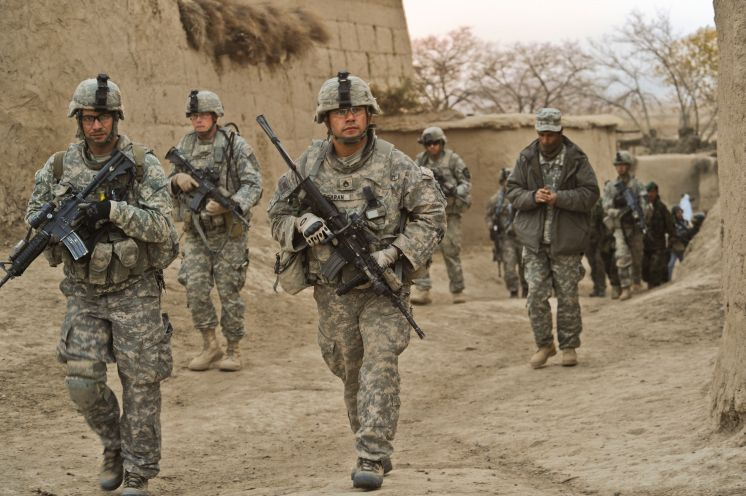 091130-F-9171L-362 U.S. Army soldiers with the 4th Battalion, 23rd Infantry Regiment, 5th Brigade Combat Team, 2nd Infantry Division and Afghan National Army soldiers conduct a combined patrol in the village of Shabila Kalan, Zabul, Afghanistan, on Nov. 30, 2009. DoD photo by Tech. Sgt. Efren Lopez, U.S. Air Force. (Released)