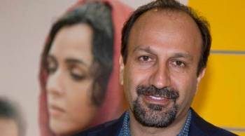 "FILE - In this Oct. 10, 2016 file photo, Iranian director Asghar Farhadi poses for a photo during the premiere of his film, ""The Salesman, in Paris. The motion picture academy calls ""extremely troubling,"" the possible visa ban of Iranian director Farhadi, whose feature film ""The Salesman"" is nominated for a best foreign language Oscar. In a statement released Saturday, Jan. 28, 2017, the Academy of Motion Picture Arts and Sciences expressed concern that Farhadi and his cast and crew may not be permitted to attend next month's Oscar ceremony in Los Angeles following President Trump's plan to temporarily suspend issuing visas for people from Iran and six other Muslim countries. (AP Photo/Michel Euler, File)"