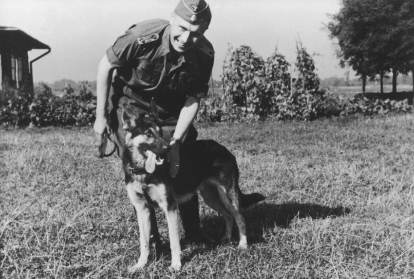 SS officer Karl Höcker pets his dog