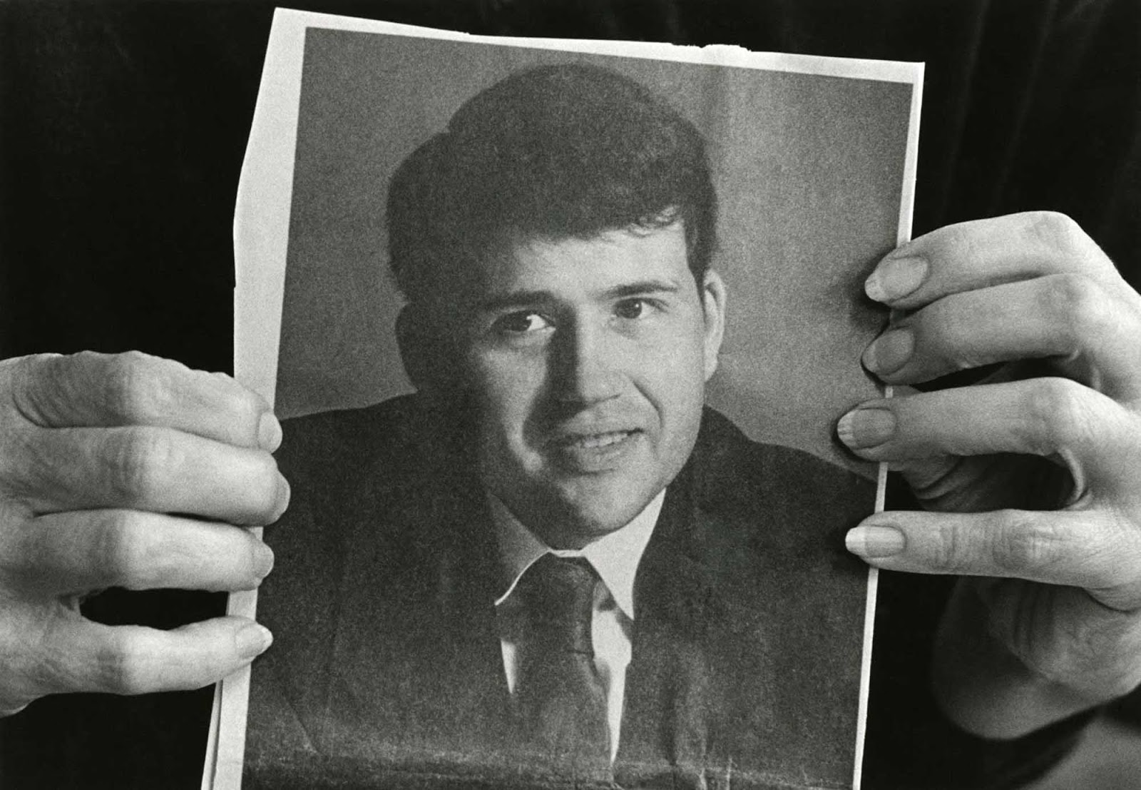 His sister shows a picture of young David Kirby.